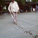 Man Painting Calligraphy With Water in Beihai Park, Beijing