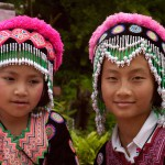 Two Girls In Traditional Garb Near Chang Mai, Thailand