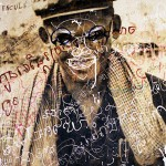 Graffiti on Photo of Former Prison Commander at Toul Sleng Genocide Museum, Phnom Pehn, Cambodia