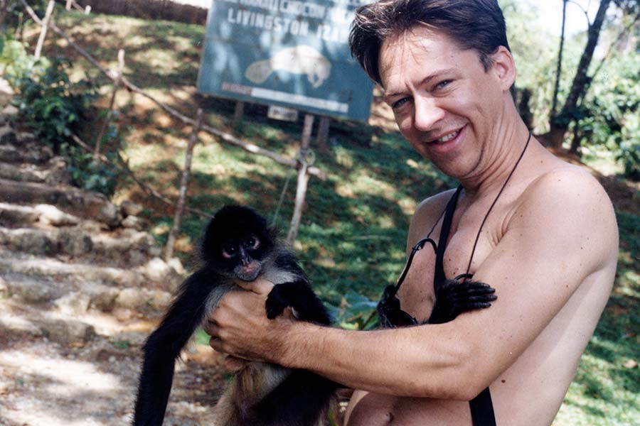 Photo of Darrell Chaddock With a Spider Monkey in Guatemala