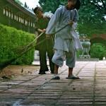 Boys Sweeping Leaves at the Thien Mu Pagoda, Hue, Viet Nam