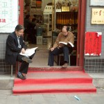 Men Reading on Liulichang Xi, Beijing