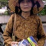 Woman Selling Post Cards and Chewing Gum in Nha Trang, Viet Nam