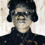 Defaced Photo of Former Khmer Rouge Guard at Toul Sleng Genocide Museum, Phnom Pehn, Cambodia