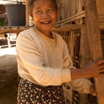 Chin Tribe Woman Grinding Corn in Rakhine State, Myanmar