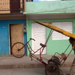 Man Pushing a Bicycle Taxi in Baracoa, Cuba