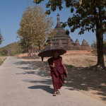 Buddhist Monk With a Parasol in Mrauk U, Myanmar