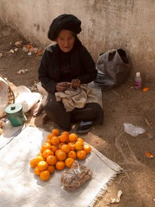 Old Woman Selling Oranges and Tamarind in Kentung, Myanmar