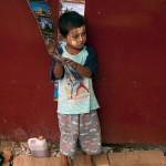 Small Boy Selling Postcards in Yangon, Myanmar
